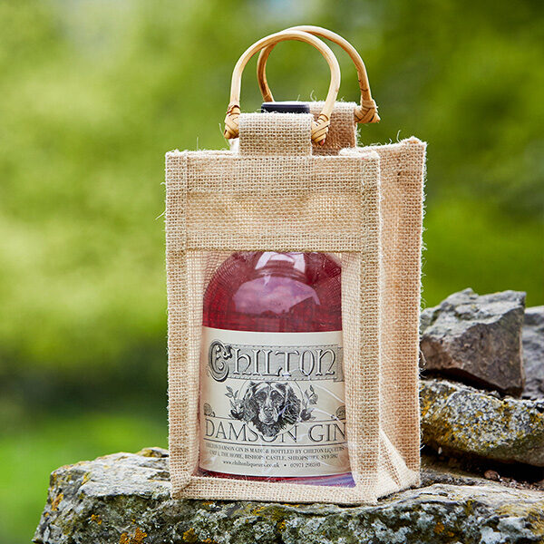 Damson gin in a bamboo carry bag